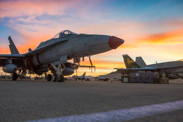 RAAF F/A-18A Hornet aircraft await their next missions on the flight line at Nellis Air Force Base, Nevada.