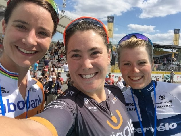 Chloe Hosking takes a podium selfie with Marianne Vos and Lotta Lepisto after winning La Course by le Tour de France.