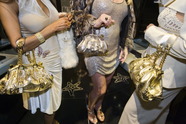 © Lauren Greenfield/INSTITUTE. Jackie [Siegel], 41, and friends with Versace handbags at a private opening at the Versace store, Beverly Hills, 2007. A Versace devotee, Jackie shopped from monthly shipments of new merchandise that the design house sent to her home. From the book, Generation Wealth (published by Phaidon).