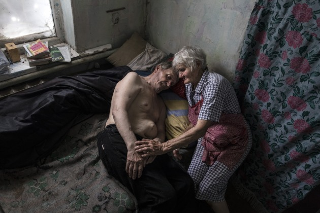 © Paula Bronstein. Opytne: Donetsk region: Raisa Petrovna, 80 and her husband Stanislav Vasilyevich reside in a village often caught in the crossfire between Ukrainian and Pro-Russian separatists. Opytne depends on humanitarian organizations to help the elderly who refuse to leave their homes and are trapped in a dangerous situation. Raisa says that they have learned to live with the sound of shelling and gunfire daily.