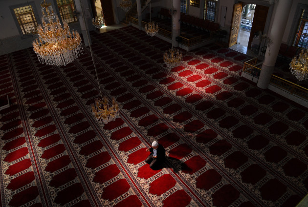 © Kate Geraghty. In the normally full Auburn Gallipoli Mosque, its general manager, Ergun Genel prays alone on the first day of Ramadan due to the COVID-19 restrictions. Auburn, NSW. 24 April, 2020.