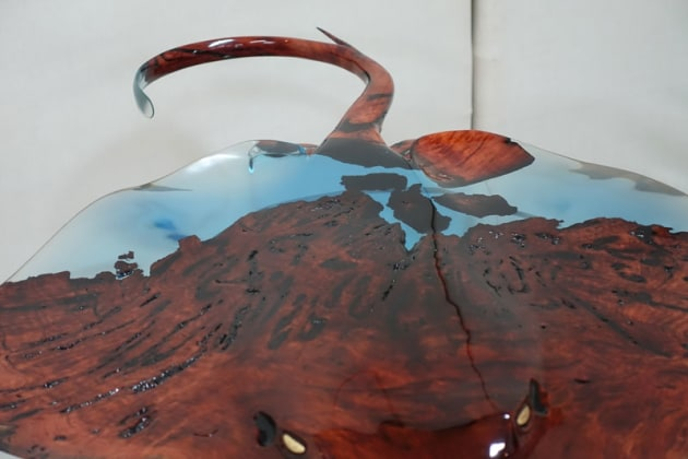 "Popular Choice winner: Josh Marks, Flight, redgum burl, epoxy resin, acrylic. ""I wanted to celebrate the marriage of ocean and earth within the form of a sculptural piece. The ocean is represented by the resin, the earth represented in the redgum burl. The transparent nature of tinted epoxy resin allows light and shadow to play an additional role in how the sculpture interacts with them."""