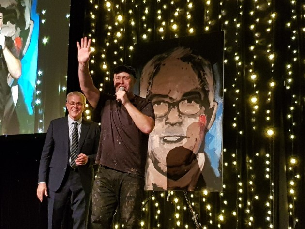 Fast painting: WPO lifetime achievement winner Keith Chessell, (left) with his portrait, knocked up by Brad Blaze in less than five minutes, keeping the crowd entertained at the PIDA gala dinner