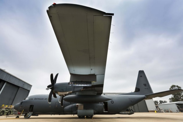A Litening sensor pod hangs from the wing of a No. 37 Squadron C-130J Hercules aircraft at RAAF Base Richmond.