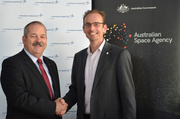 Rod Drury, Managing Director Australia and NZ Lockheed Martin Space (left) and Anthony Murfett, Acting Head Australian Space Agency mark the official signing.