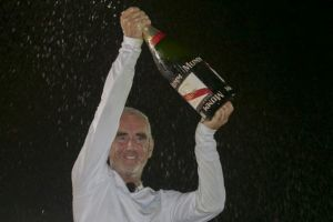 Loick Peyron celebrates his Route du Rhum victory and race record. Photo Alexis Courcoux.