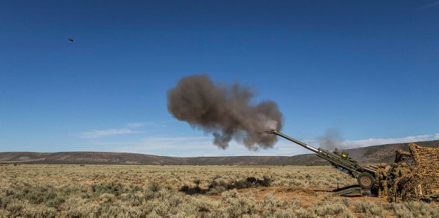 Australian Army soldiers from 8th/12th Regiment fire the 155 mm M777A2 towed lightweight howitzer during Exercise Thunder Run at Cultana training area. Credit: Defence
