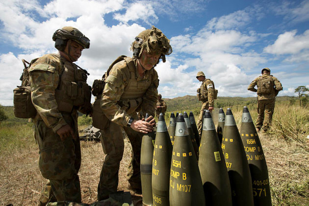 Australian Army soldiers from 8th/12th Regiment prepare rounds for the 155 mm M777A2 towed lightweight howitzer. Credit: Defence