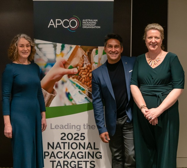 APCO chair Sam Anderson, TV personality Jamie Durie, and APCO CEO Brooke Donnelly with signage showing the new APCO logo.