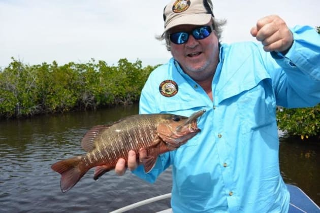 Macca with one of the many mangrove Jacks caught over 5 days