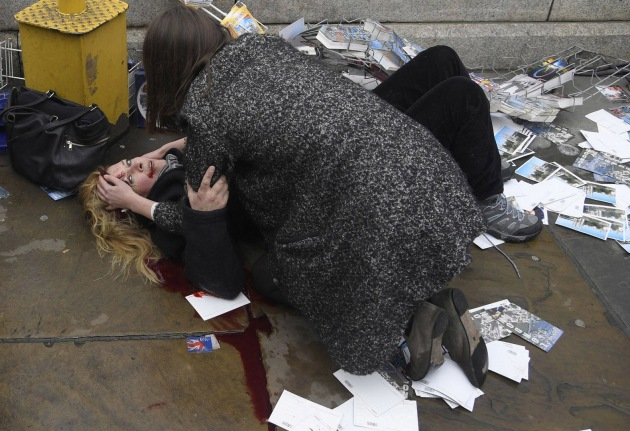 Witnessing the Immediate Aftermath of an Attack in the Heart of London. World Press Photo of the Year Nominee. © Toby Melville. 