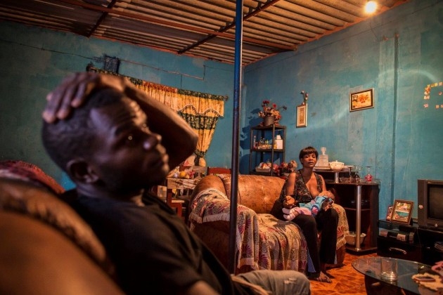 © Cory Richards. In her home in Luanda, Lola, her baby, and her cousin Caesar discuss the legacy of decades of war and their hopes for Angola's future. From National Geographic's story on the Okavango Delta.