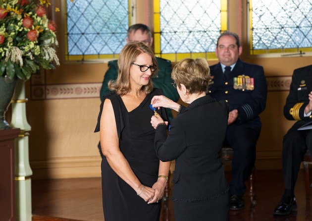 Governor Beazley invests Nadia Taylor as a Member of the Order of Australia (AM).