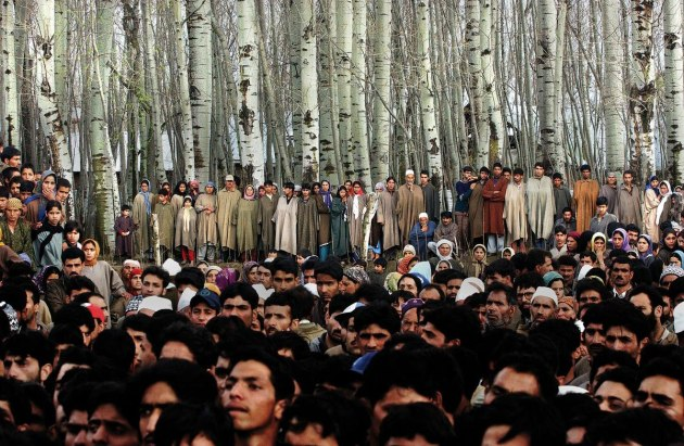 © Ami Vitale. Villagers mourn the death of five people who were killed along with 48 who were injured, when a grenade exploded in the hands of a man who was seeking to extort money from a family in Badgam district of Kashmir, 10 March, 2004.