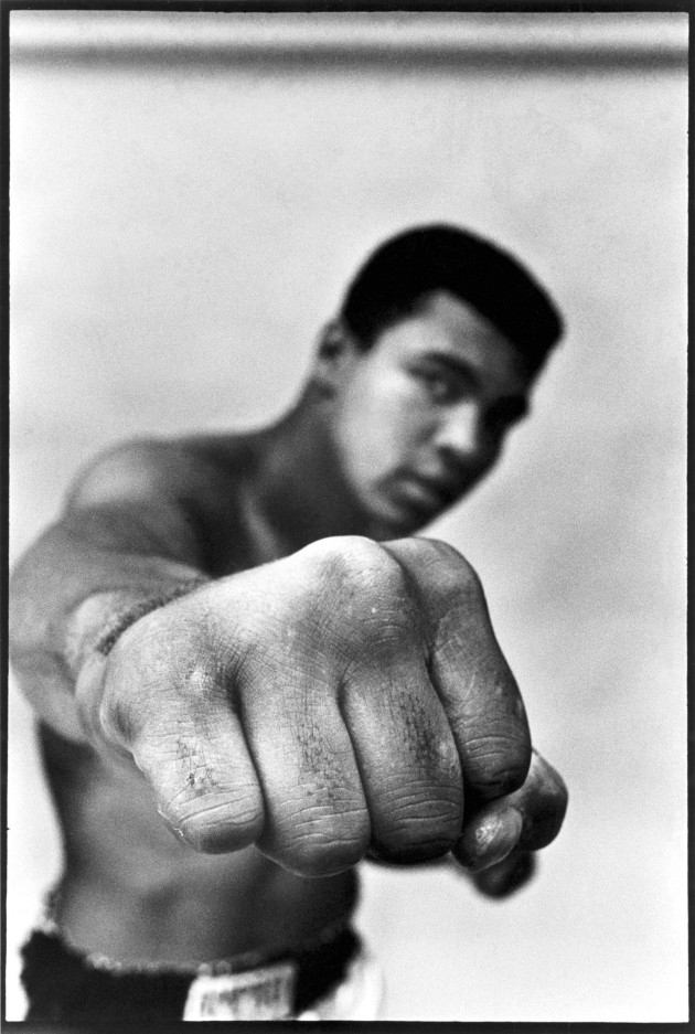 "© Thomas Hoepker/Magnum Photos Muhammad Ali, boxing world heavyweight champion showing off his right fist. Chicago, USA. 1966. ""This picture came immediately to my mind when I was asked to consider the theme of 'Solidarity'. The world right now is on edge in every sense and only by helping and encouraging each other will we get through this incredible global crisis. What picture would possibly better represent strength and the determination to fight for equality, unity and justice? As Muhammad Ali said in an interview with Playboy magazine in 1975: 'I would like to be remembered as a black man who won the heavyweight title and who was humorous and who treated everyone right. As a man who never looked down on those who looked up to him and who helped as many of his people as he could — financially and also in their fight for freedom, justice and equality.'"""