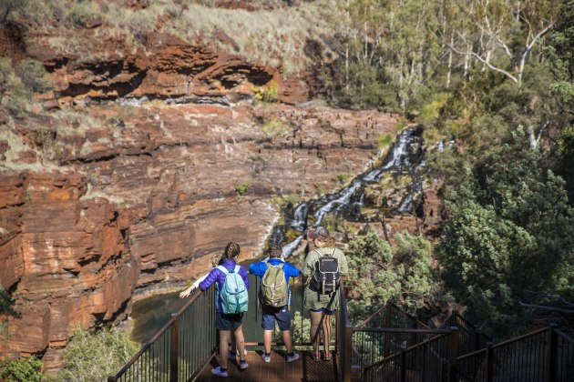Peering down into the gorges of Karijini NP. Tourism WA