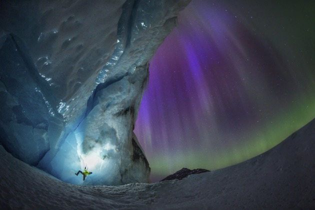 "© Paul Zizka. Ice climbing under the night sky at Athabasca Glacier, Jasper National Park, Canada. ""The Northern Lights evolved constantly over several hours, occasionally displaying a nice array of purples."""