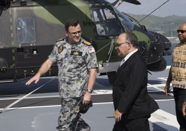 Commanding Officer HMAS Adelaide Captain Jonathan Earley talks with PNG Prime Minister Peter O'Neill.