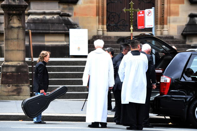 Dean Lewins won the Nikon-Walkley Press Photographer of the Year. Angus Young waits to place a guitar in the hearse with the casket of his brother, AC/DC co-founder and guitarist, Malcolm Young. The funeral was held at St. Mary's Cathedral in Sydney, in November 2017.