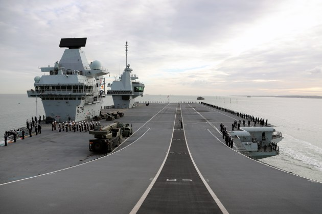 HMS Queen Elizabeth sails back into Portsmouth after successful completion of initial fast jet trials.