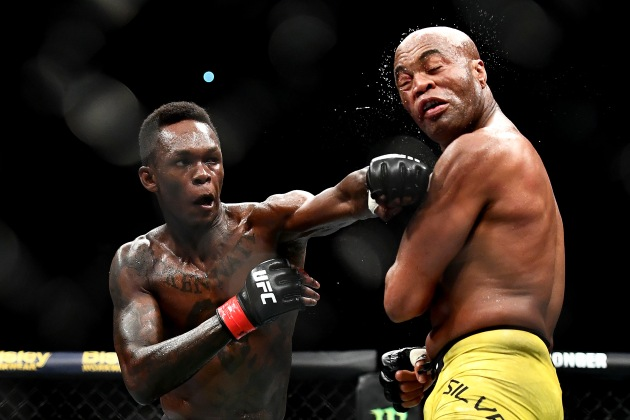© Quinn Rooney. The Art of Sports Photography. Israel Adesanya of Nigeria punches Anderson Silva of Brazil during their Middleweight bout during UFC234 at Rod Laver Arena on February 10, 2019 in Melbourne, Australia.