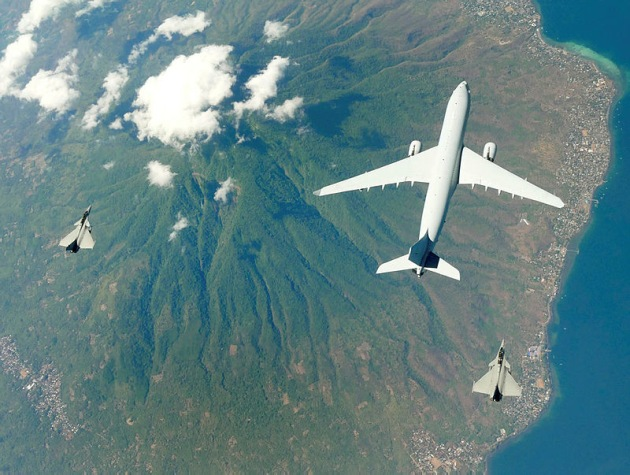 French Dassault Rafales fly in formation with a No. 33 Squadron KC-30A Multi Role Tanker Transport aircraft en route to Australia to participate in Ex Pitch Black 2018.
