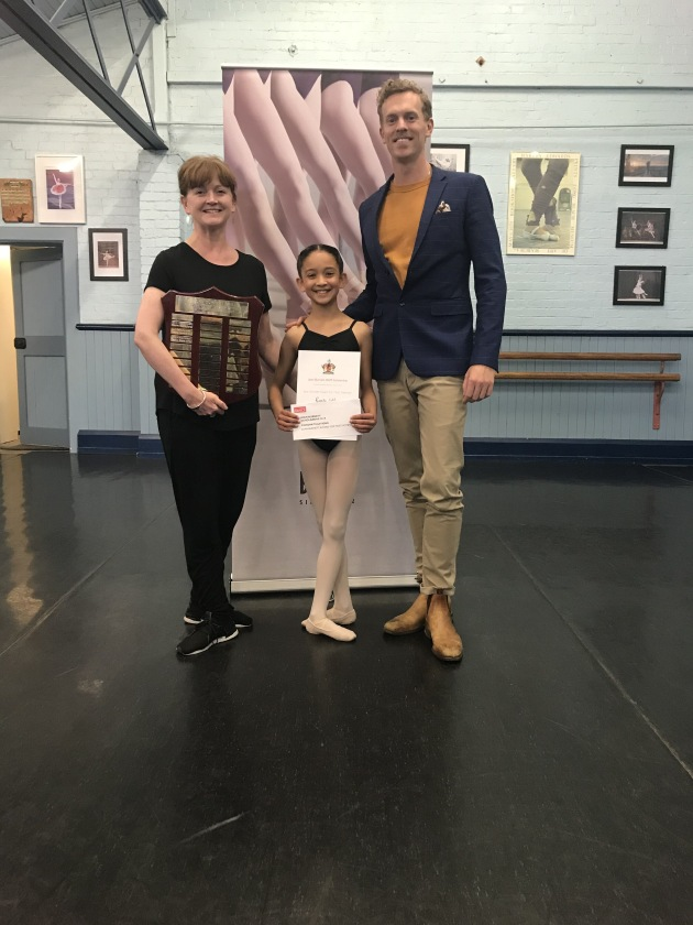 Overall winner Ramita Coldrey with teacher Shayne Davies and Adam Bull.