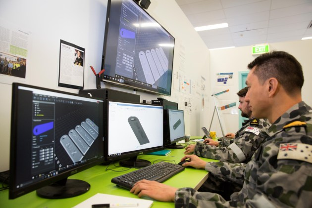 Royal Australian Navy personnel, Lieutenant Kit Low (foreground), from HMAS Waterhen and Leading Seaman Electronics Technician Callum Spence, from HMAS Kuttabul, use Computer Aided Design to develop ideas at the Centre for Innovation, Fleet Base East in Sydney.