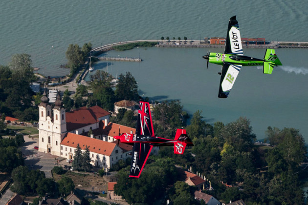 Britain's Ben Murphy and Frenchman Francois Le Vot fly over a Bendictine abbey on the shores of Hungary's Lake Balaton. (Daniel Grund / Red Bull Content Pool)