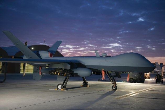 An MQ-9 Reaper equipped with an extended range modification sits on the ramp at Kandahar Airfield, Afghanistan. 