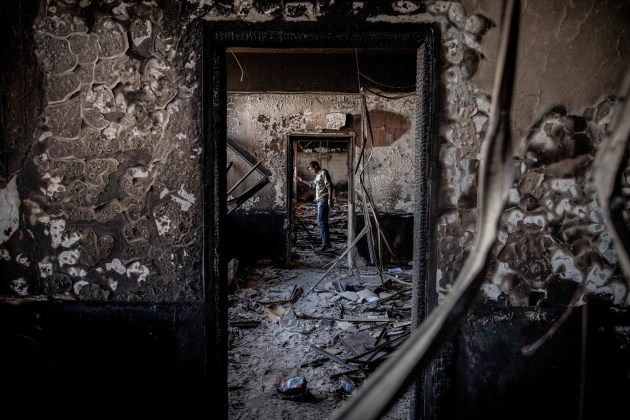 The Libyan Revolution. A man in a government building on the outskirts of Benghazi that had been burned by the opposition, 28 February, 2011. © Nichole Sobecki.