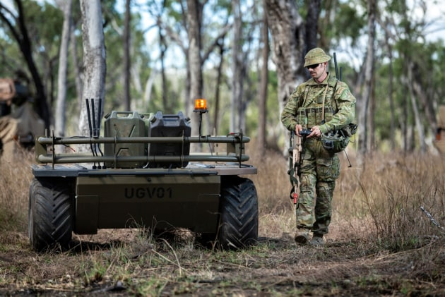 Corporal Aaron Le Jeune from the 9th Force Support Battalion trials an unmanned ground vehicle.