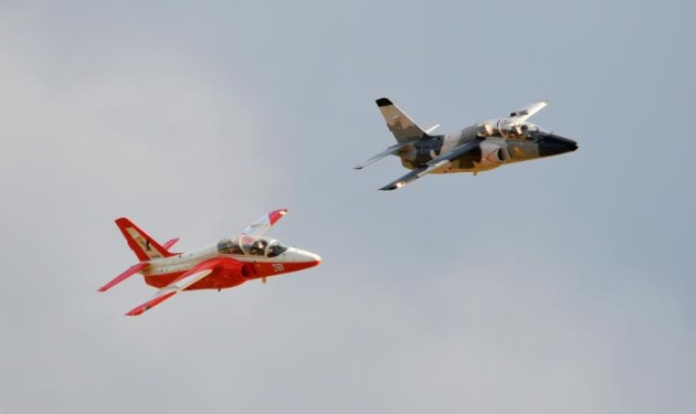 Two SIAI Marchetti S.211s roll out along the air show centre line. (Steve Hitchen)