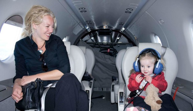Mum Sarah and baby Lotus on Bill Bristow's Pilatus during an Angel Flight mission. (Angel Flight / Geoff Marsh)