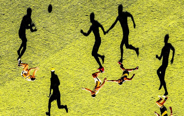 © Scott Barbour. A general view as long shadows are cast by Shane Edwards of the Tigers as he competes for the ball during the round nine AFL match between the Richmond Tigers and the Hawthorn Hawks at Melbourne Cricket Ground on May 19, 2019 in Melbourne, Australia.