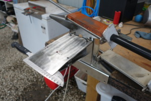 The Scary Sharp Precision Knife Sharpening System holds the blade at a constant angle.