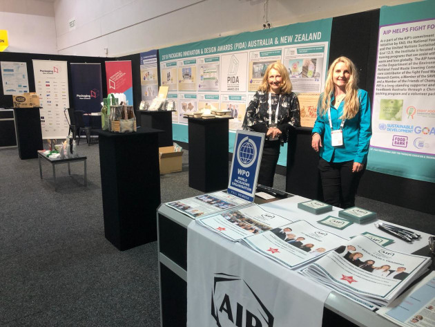 Packaging NZ executive director Sharon Humphreys and AIP executive director Nerida Kelton on the joint stand displaying the PIDA winners.