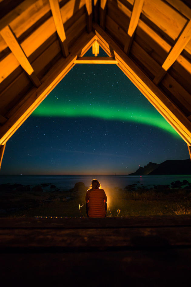 Sitting under the Northern Lights, Iceland, © @coldxneil