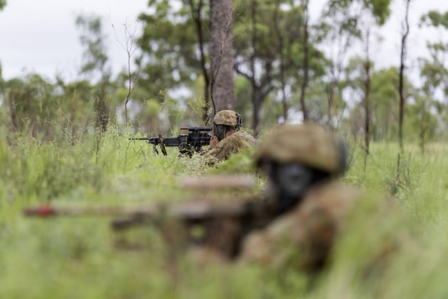 Australian Army officer trainees conduct a patrol during the Royal Military College training activity near Townsville, Queensland.