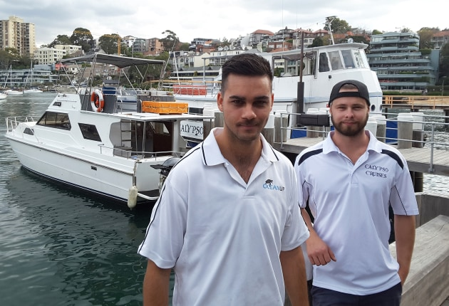 Young guns going for it: Alex Cavallaro (left) and Luke Feledy with their charter vessels on Sydney Harbour.