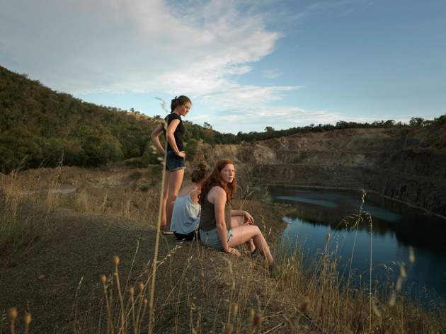 The girls, 2017 by Tamara Dean. A tight-knit group of teenage girls from regional south-west NSW look out over a local quarry on the outskirts of town, a place where local teens cool off in the heat of summer. Extending on my 2013 series The Edge, this image is part of a series exploring the relationship between young people and nature in contemporary regional life. Having photographed these girls in a number of locations, I was struck by their fearless, playful, adventurous spirits, a result of them growing up on the land. This project was initiated and commissioned by The Wired Lab.