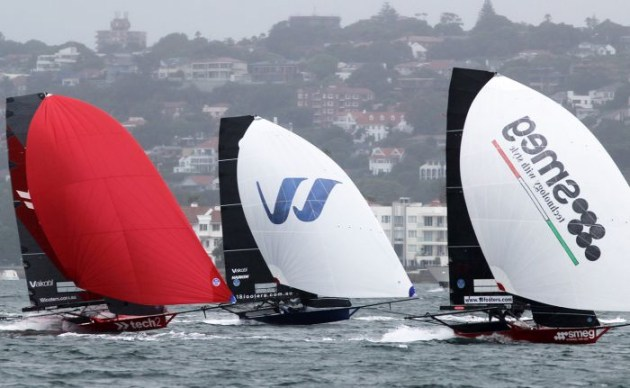 Three leaders race to the finish line in Race 4. Photo Michael Chittenden 18 Footers League.