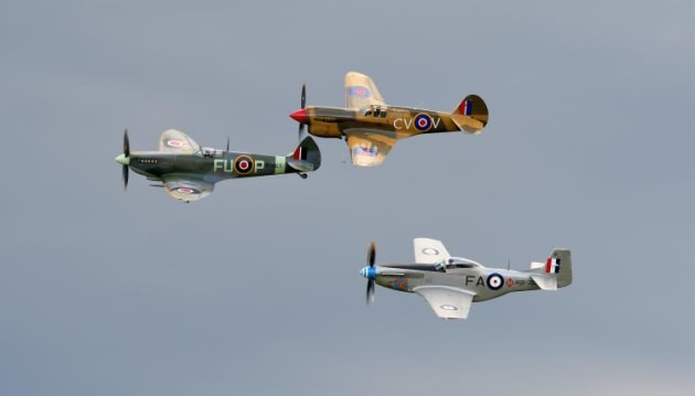 Three iconic WWII fighters in formation: Spitfire, P-40 Kittyhawk and CA-18 Mustang. (Steve Hitchen)