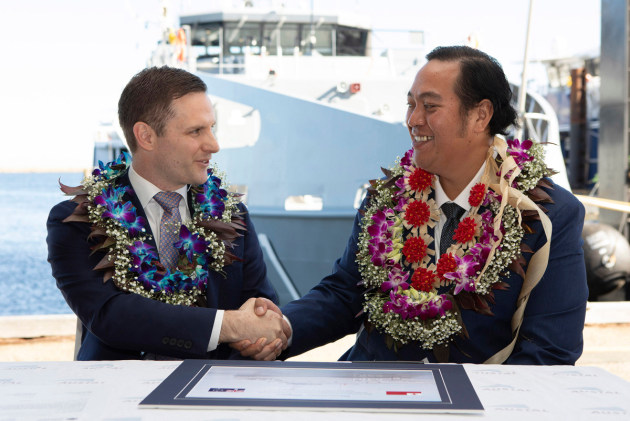 Assistant Minister for Defence Alex Hawke co-signs the handover certificate with Crown Prince Tupouto'a 'Ulukalala.