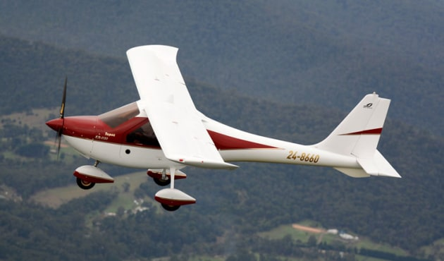 The glider heritage of the Ekolot Topaz is evident in the wing profile.