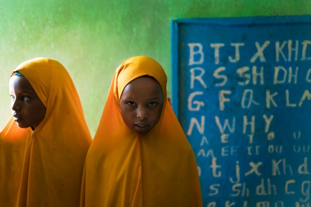 Girls wearing their local school uniform in class at Hadew primary school, Jijiga, Ethiopia. © Simon Lister.