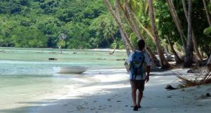 Alvah walks down a beach in the Torres Islands