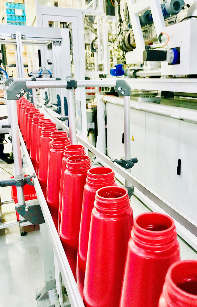 Production line for Wellman Packaging's Squeezy Sauce bottle, made from 90% food grade rPE.
