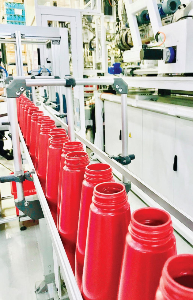 Wellman's production line for the 90% recycled, food grade PE squeezy sauce bottle.
