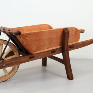 Myles Gostelow, A Barrow to Push, silky oak, elm, claret ash. 'This timber wheelbarrow was inspired by, and pays tribute to, the early work of Charles Weston and the role he played in greening the Nation's Capital between 1911–1926. Charles Weston was an English-born horticulturalist and in all, Weston was responsible for the planting of two million trees and shrubs in Canberra during this time.